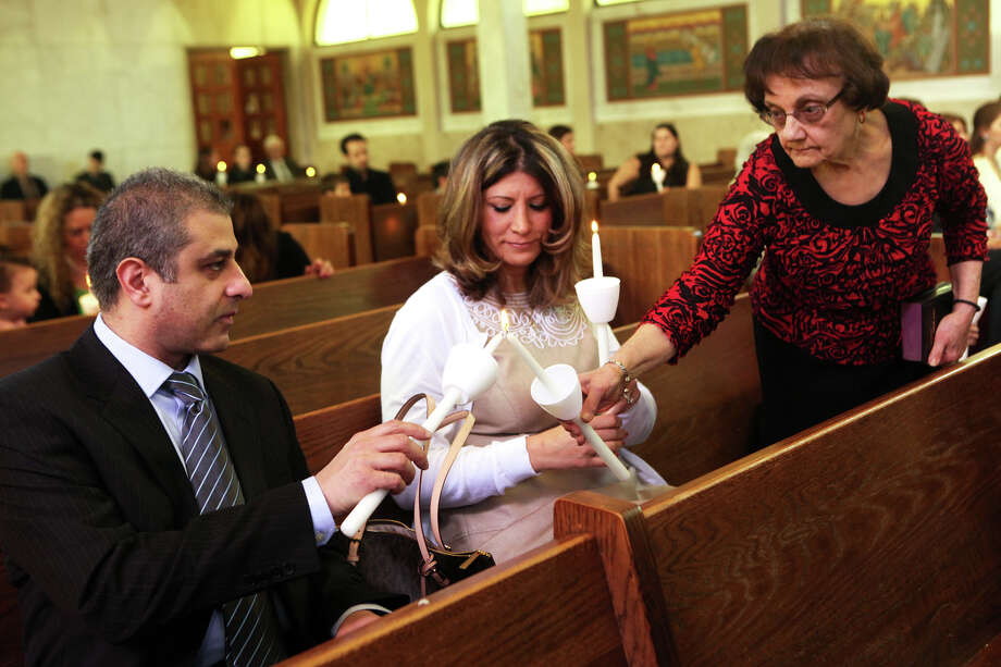 Sophia Tordmandies lights candles for Mona and Tony Mitri during Holy Trinity Greek Orthodox Church's Easter Sunday Mass in Bridgeport, Conn. on May 5, 2013. Photo: BK Angeletti, B.K. Angeletti / Connecticut Post freelance B.K. Angeletti
