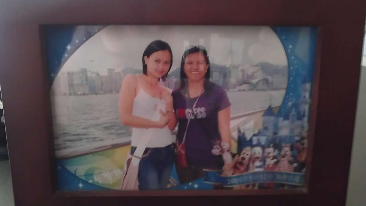 Mary Grace Guardiano, right, with an unidentified woman in a family photo. Guardiano was one of five people who survived a limousine fire on the San Mateo Bridge on May 4, 2013, that killed five women on their way to a bridal shower.