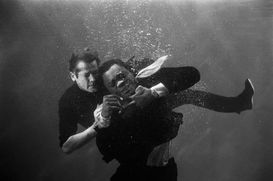 British actor Roger Moore as James Bond in the underwater fight scene with Yaphet Kotto from the movie Live and Let Die. Photo: Terry O'Neill, Getty / Terry O'Neill