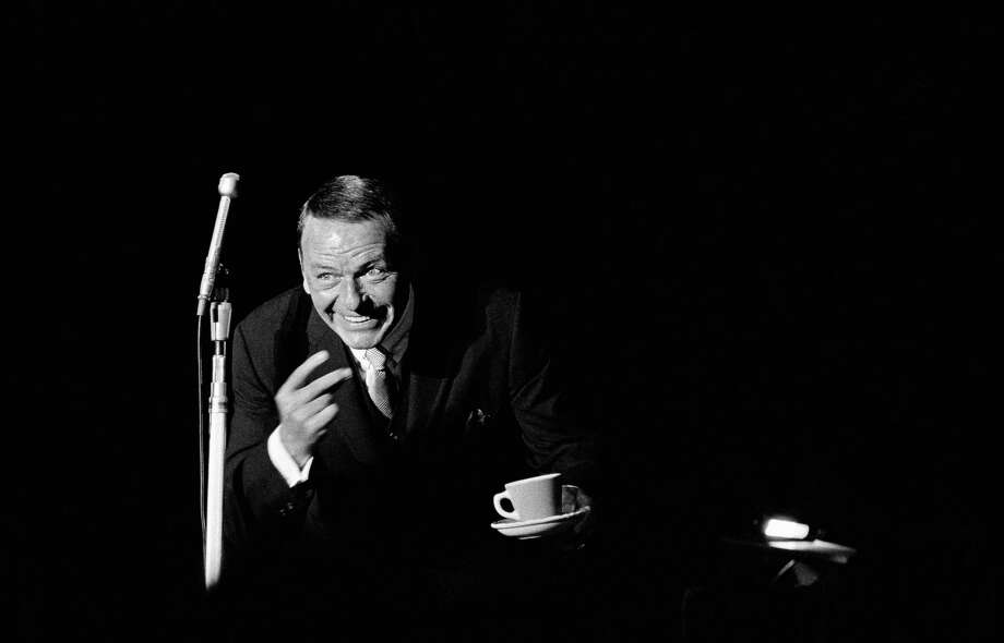American singer and actor Frank Sinatra on stage with a cup and saucer, circa 1970. Photo: Terry O'Neill, Getty / 2008 Getty Images
