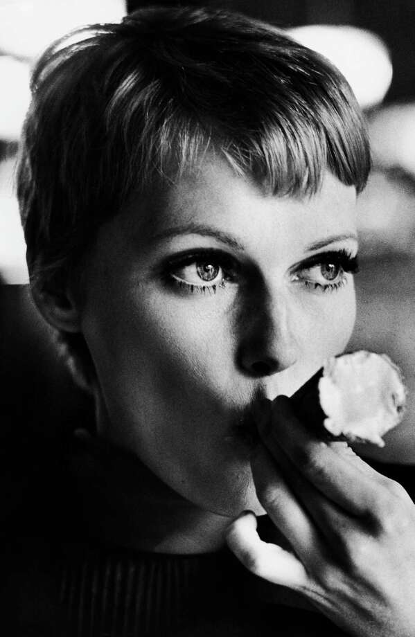 American actress Mia Farrow sucking the end of an ice cream cornet, late 1970s. Photo: Terry O'Neill, Getty / 2005 Getty Images