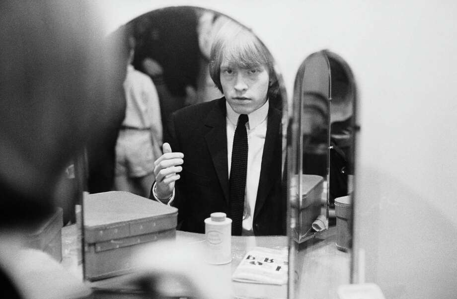 Rolling Stones guitarist Brian Jones looking in a dressing table mirror backstage, mid 1960s. Photo: Terry O'Neill, Getty / 2006 Getty Images