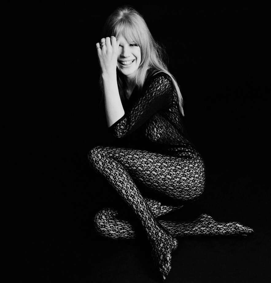 Singer and actress Marianne Faithfull posing in a black lace bodystocking, mid 1960s. Photo: Terry O'Neill, Getty / 2006 Getty Images