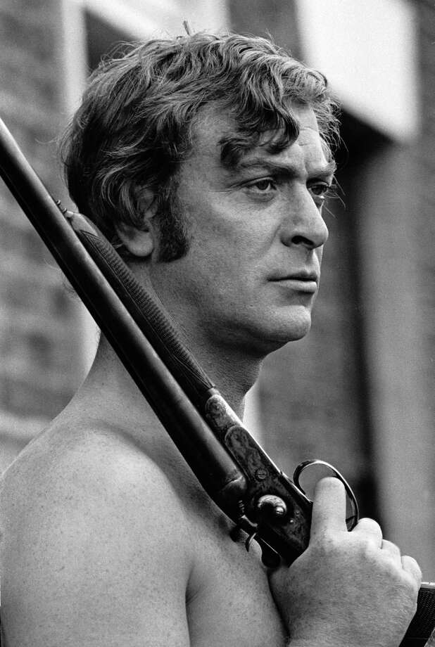 British actor Michael Caine toting a shotgun topless on the set of 'Get Carter', circa 1971. Photo: Terry O'Neill, Getty / 2006 Getty Images