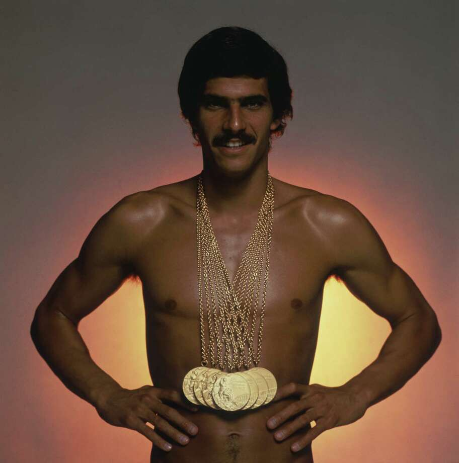 American swimmer Mark Spitz, circa 1973, with the seven gold medals, which he won at the 1972 Munich Olympic Games. Photo: Terry O'Neill, Getty / 2005 Getty Images