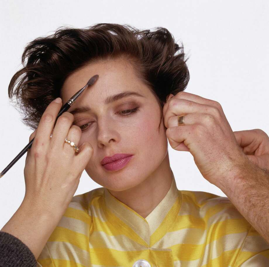 Italian model and film actress Isabella Rossellini, has her make up touched up between photographs, December 1988. Photo: Terry O'Neill, Getty / 2005 Getty Images