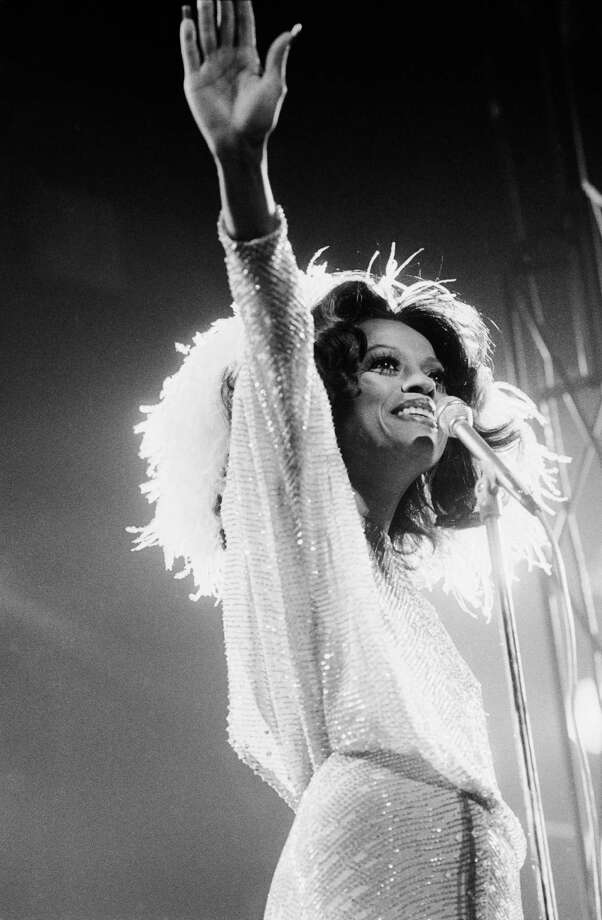 American soul singer Diana Ross is backlit by the stage lights during a concert, circa 1975. Photo: Terry O'Neill, Getty / 2005 Getty Images