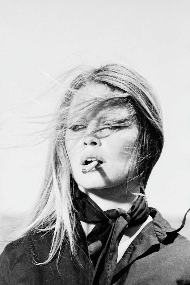 French actress Brigitte Bardot smoking a slim cigar while in Spain, 1971. Photo: Terry O'Neill, Getty / 2005 Getty Images