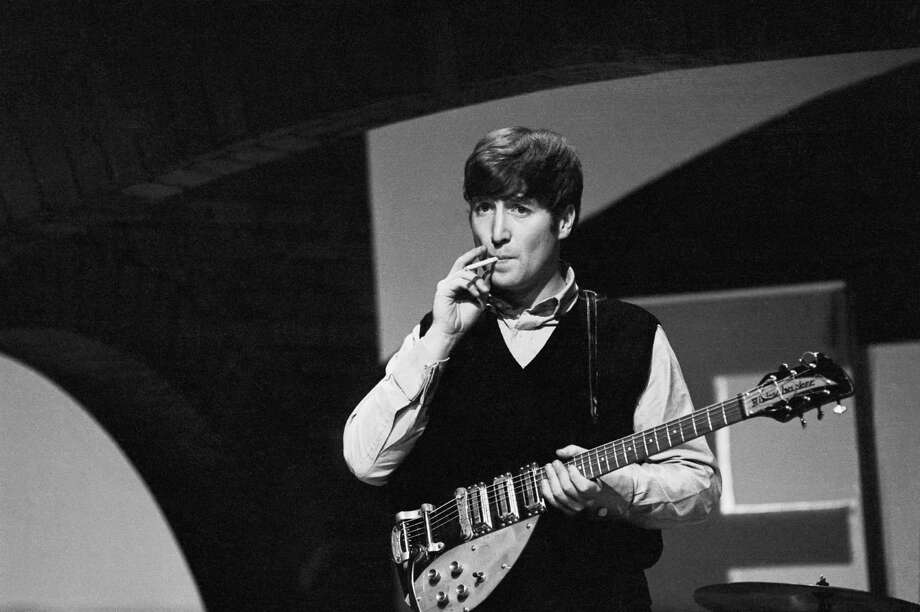 Guitarist and songwriter John Lennon smoking a cigarette during a rehearsal at Twickenham Studios, London, 1963. Photo: Terry O'Neill, Getty / 2005 Getty Images
