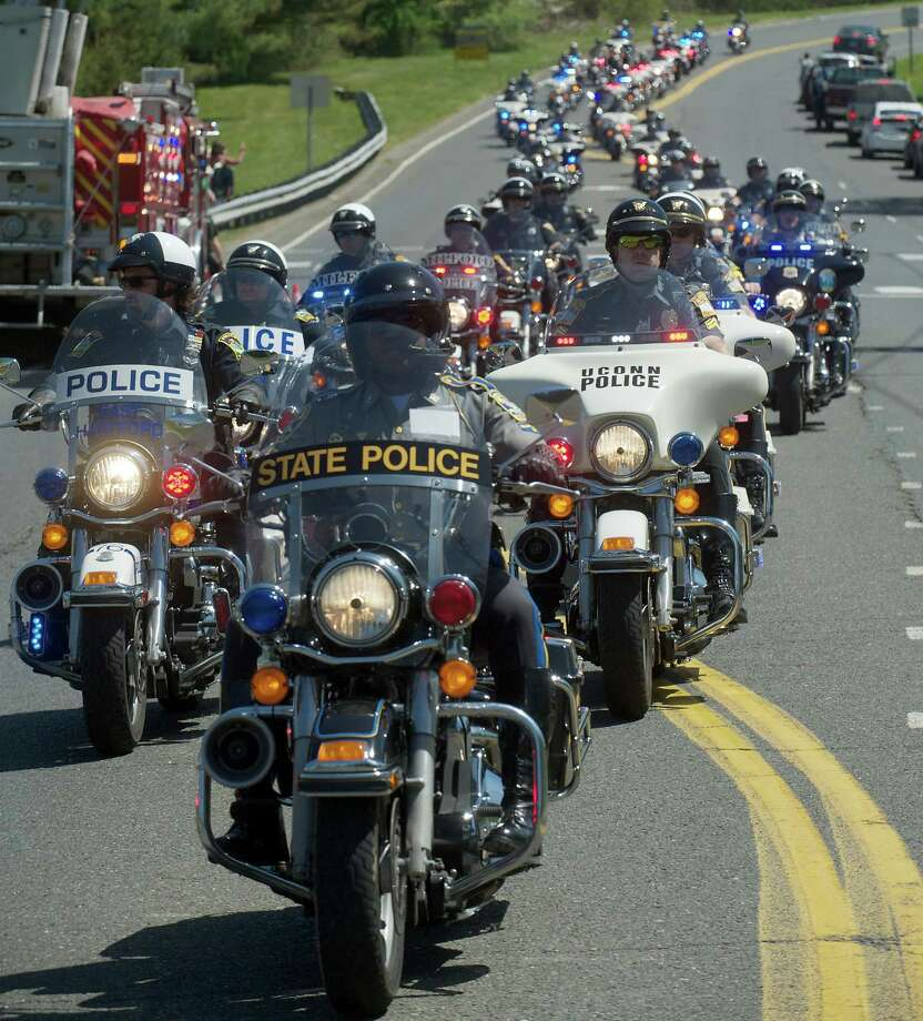 Troopers and officers with motorcycle units from across the state lead the procession of riders taking part in the Green Ribbon Ride as it passes through Newtown, Conn on Sunday, May 5th, 2013. Photo: H John Voorhees III