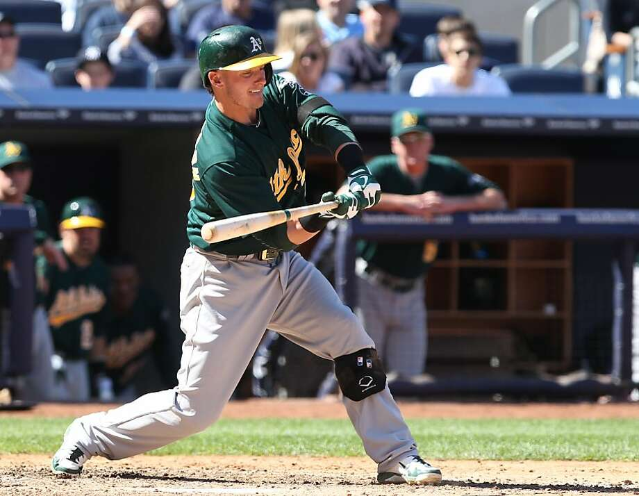 Oakland Athletics Josh Donaldson hits a solo home run in the eighth inning of an MLB American League baseball game against the New York Yankees in New York on Sunday, May 5, 2013. (AP Photo/Peter Morgan) Photo: Peter Morgan, Associated Press