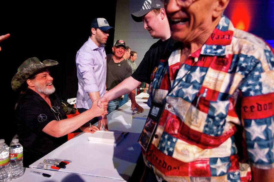 NRA member and musician, Ted Nugent, greets fans and signs autographs at the National Rifle Association's 142 Annual Meetings and Exhibits in the George R. Brown Convention Center Sunday, May 5, 2013, in Houston. 