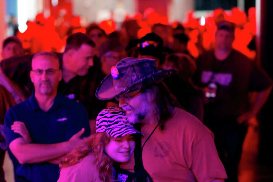 Les Baillio of Cypress, hugs his daughter Makayla, 13, while waiting to meet Ted Nugent at the National Rifle Association's 142 Annual Meetings and Exhibits at the George R. Brown Convention Center Sunday, May 5, 2013, in Houston. 