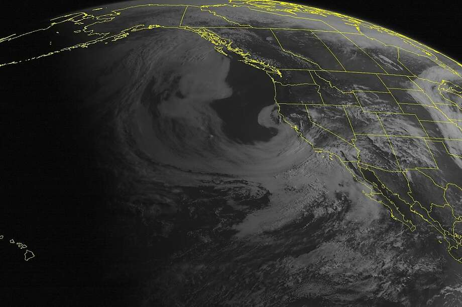 This NOAA satellite image taken Sunday, May 05, 2013 at 11:00 AM EDT shows showers and scattered thunderstorms across California into the Great Basin and Southwest. Fair weather is seen over the Pacific Northwest and Northern Rockies. Photo: Associated Press
