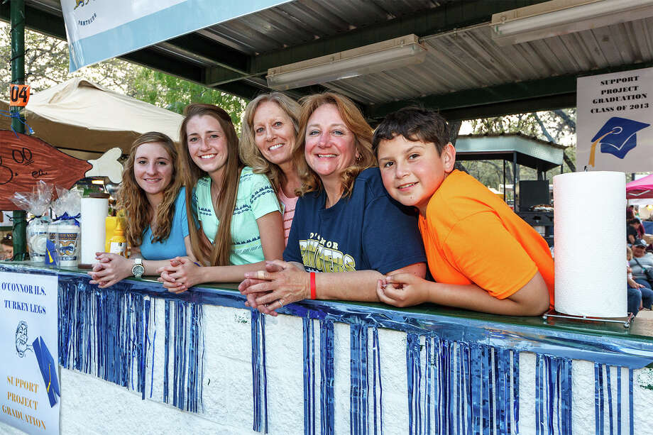 Ethan Huerta (13, from right), Paige Alexander, Sandee Maddock, Fictoria Maddock (15) and McKenzey Burke (16) pose for a photo while working the O'Connor High School Project Graduation booth selling turkey lega at the 47th annual Cornyval on the Helotes Festival Grounds on Saturday, May 4, 2013.  Photo by Marvin Pfeiffer / Prime Time Newspapers Photo: MARVIN PFEIFFER, Marvin Pfeiffer / Prime Time New / Prime Time Newspapers 2013
