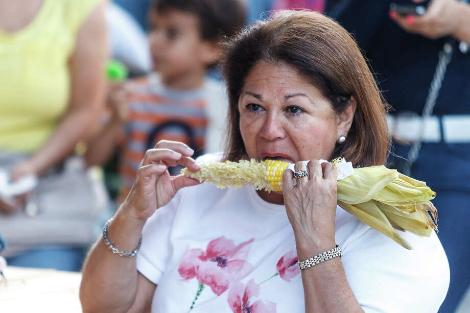 Helotes resident Sylvia Esparze enjoys a roasted corn-on-the cob during the 47th annual Cornyval on the Helotes Festival Grounds on Saturday, May 4, 2013.  Photo by Marvin Pfeiffer / Prime Time Newspapers Photo: MARVIN PFEIFFER, Marvin Pfeiffer / Northwest Weekly / Prime Time Newspapers 2013