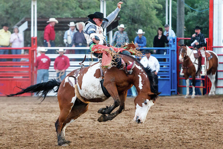 A bareback bronc riderdoes his best to hang on during the Rodeo at the 47th annual Cornyval on the Helotes Festival Grounds on Saturday, May 4, 2013.  Photo by Marvin Pfeiffer / Prime Time Newspapers Photo: MARVIN PFEIFFER, Marvin Pfeiffer / Northwest Weekly / Prime Time Newspapers 2013