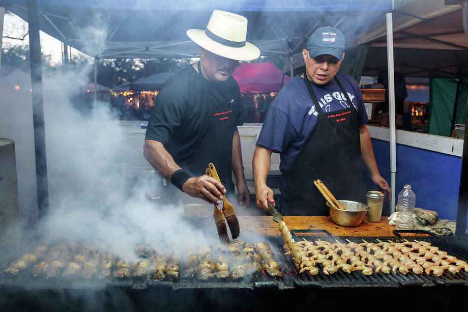 """Ace Carter (left) and David Benitez grill shrimp, chicken and steak k-bobs at the """"A Little Taste of Heaven on a Stick""""  booth at the 47th annual Cornyval on the Helotes Festival Grounds on Saturday, May 4, 2013.  Photo by Marvin Pfeiffer / Prime Time Newspapers Photo: MARVIN PFEIFFER, Marvin Pfeiffer / Prime Time New / Prime Time Newspapers 2013"""