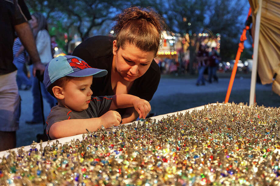 Debbie Ward watches as her three-year-old son Troy Ward picks out a miniature handmade pewter figurine at the 47th annual Cornyval on the Helotes Festival Grounds on Saturday, May 4, 2013.  Photo by Marvin Pfeiffer / Prime Time Newspapers Photo: MARVIN PFEIFFER, Marvin Pfeiffer / Prime Time New / Prime Time Newspapers 2013