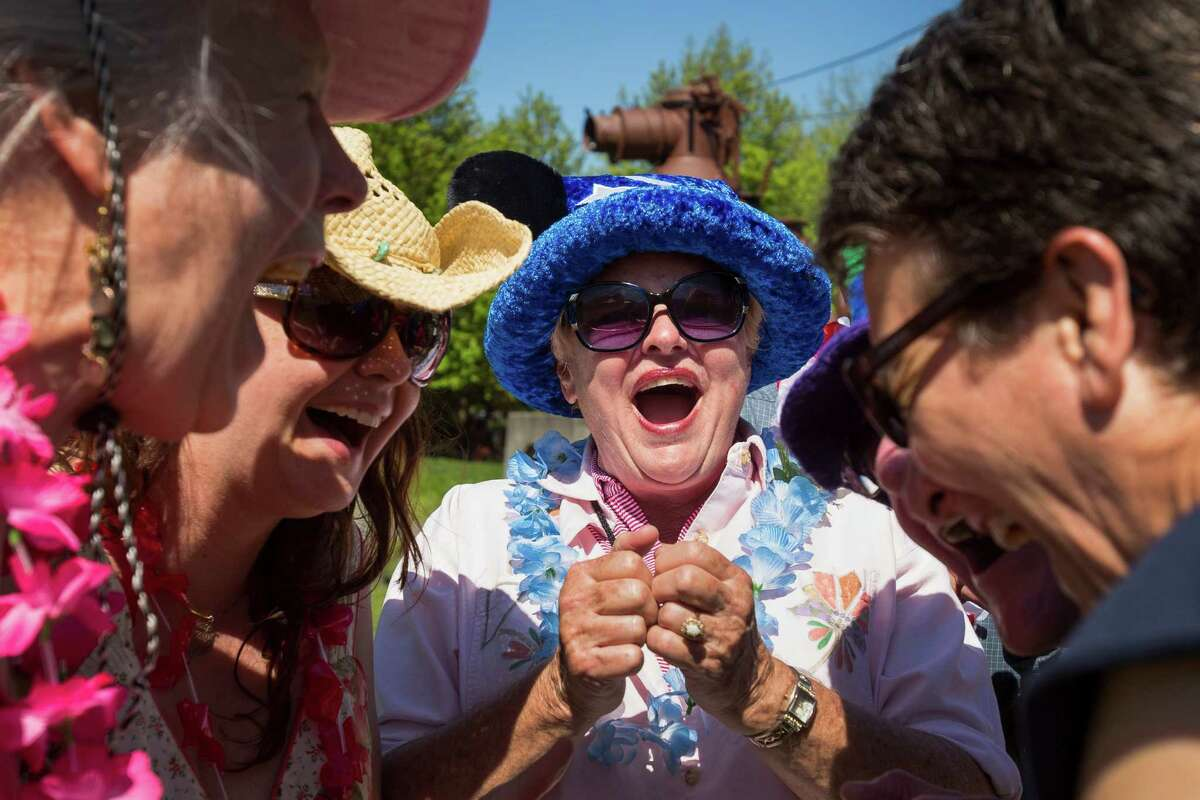 A mix of joining walk-on attendees and members of the Tee Hee Hee Laughter group giggle and chuckle their way through a series of group exercises in celebration of World Laughter Day Sunday, May 5, 2012, at Gas Works Park in Seattle. The group invests in the popular idea that laughter as a body exercise warrants physiological and psychological benefits.