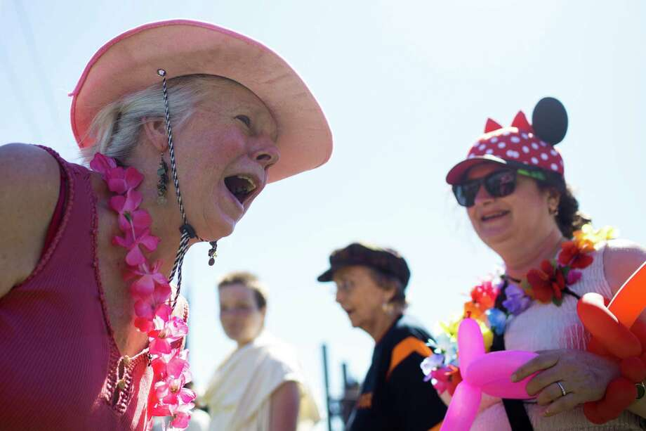 Katy Carnes, left, giggles with others during a group exercise in celebration of World Laughter Day Sunday, May 5, 2012, at Gas Works Park in Seattle. The group invests in the popular idea that laughter as a body exercise warrants physiological and psychological benefits. Photo: JORDAN STEAD, SEATTLEPI.COM / SEATTLEPI.COM