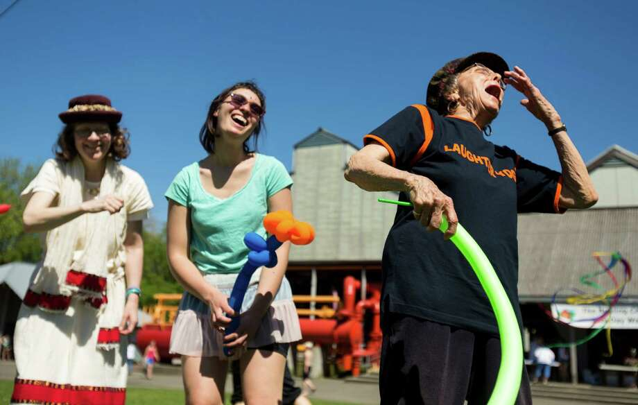 A mix of joining walk-on attendees and members of the Tee Hee Hee Laughter group giggle and chuckle their way through a series of group exercises in celebration of World Laughter Day Sunday, May 5, 2012, at Gas Works Park in Seattle. The group invests in the popular idea that laughter as a body exercise warrants physiological and psychological benefits. Photo: JORDAN STEAD, SEATTLEPI.COM / SEATTLEPI.COM