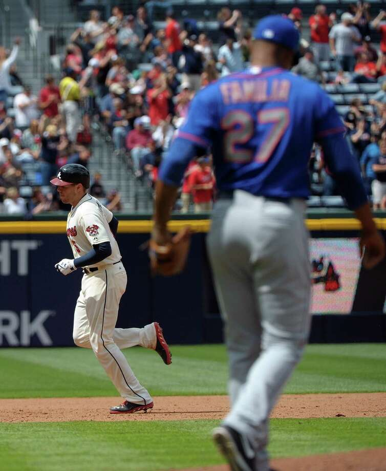 Atlanta Braves' Freddie Freeman rounds the bases behind New York Mets relief pitcher Jeurys Familia after Freeman's home run in the eighth inning of a baseball game at Turner Field, Sunday, May 5, 2013, in Atlanta. Atlanta won 9-4. (AP Photo/David Tulis) Photo: Dave Tulis