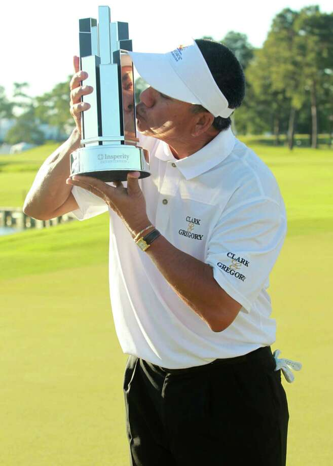 Esteban Toledo kisses his trophy after defeating Mike Goodes on the third playoff hole during the final round of the Insperity Championship, Saturday, May 4, 2013 at The Woodlands Country Club Tournament Course in The Woodlands, TX. (Photo: Eric Christian Smith/For the Houston Chronicle) Photo: Eric Christian Smith, For The Chronicle
