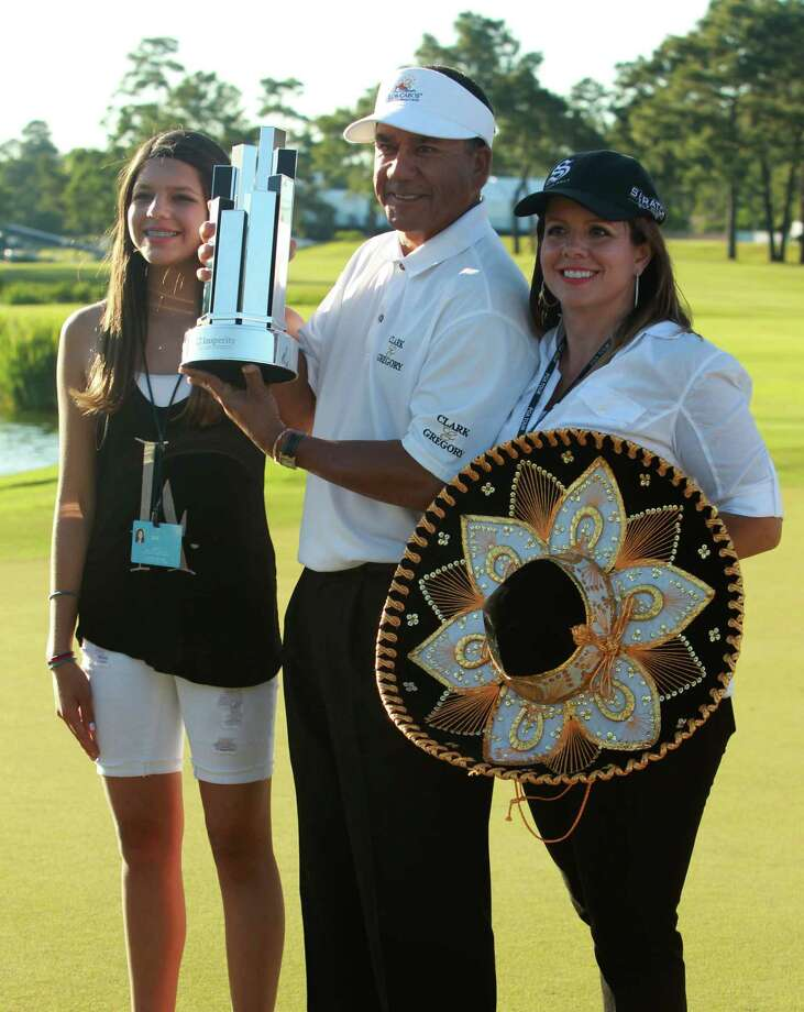Esteban Toledo with his wife Colleen (right) and daughter Eden after defeating Mike Goodes on the third playoff hole during the final round of the Insperity Championship, Saturday, May 4, 2013 at The Woodlands Country Club Tournament Course in The Woodlands, TX. (Photo: Eric Christian Smith/For the Houston Chronicle) Photo: Eric Christian Smith, For The Chronicle