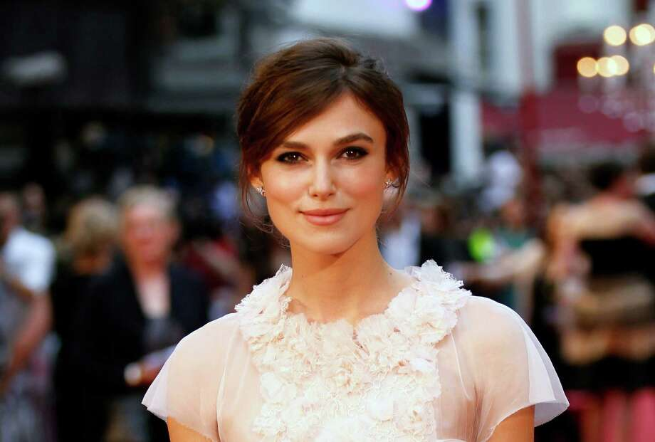 FILE- British actress Keira Knightley poses as she arrives for the world premiere of Anna Karenina in London, in this file photo dated Tuesday, Sept. 4, 2012.  French mayor Aime Navello said Sunday May 5, 2013, that he officiated on Saturday May 4, during the wedding of Oscar-nominated actress Keira Knightley to keyboard player for the Klaxon rock group James Righton, during a simple French ceremony at the Mazan town hall in southern France. (AP Photo/Sang Tan, File) Photo: Sang Tan
