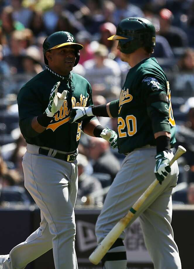 NEW YORK, NY - MAY 05:  Yoenis Cespedes #52 of the Oakland Athletics celebrates his two RBI home run with teammate Josh Donaldson #20 against the New York Yankees at Yankee Stadium on May 5, 2013 in the Bronx borough of New York City.  (Photo by Nick Laham/Getty Images) Photo: Nick Laham, Getty Images