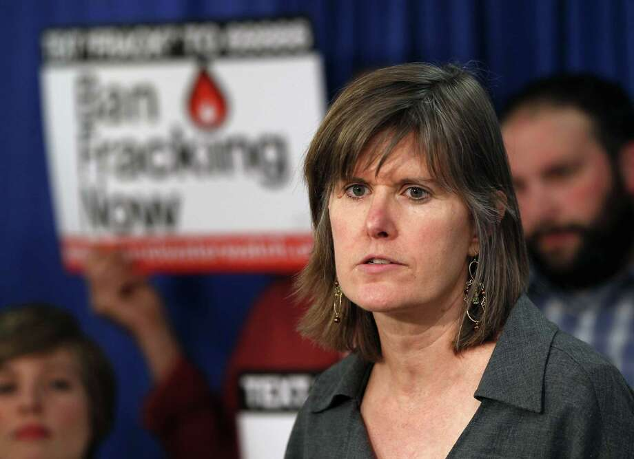 FILE - In this March 26, 2012 file photo, author Sandra Steingraber speaks during a New Yorkers Against Fracking news conference in Albany, N.Y. Steingraber, who is at the forefront of the anti-fracking movement in New York, was jailed for blocking access to a gas storage project in the Finger Lakes. (AP Photo/Mike Groll, File) Photo: Mike Groll