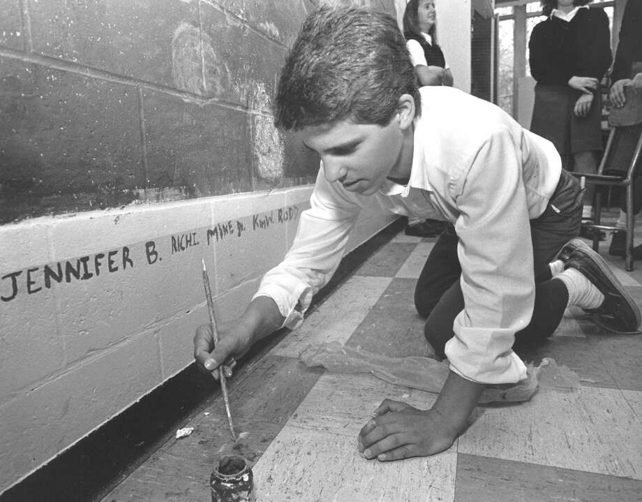 "Rod Salvatore, an eighth-grader at St. Gabriel's Middle School in Stamford, adds his name to his class' recreation of Monet's ""Water Lilies"" on May 6, 1988. Photo: Advocate"
