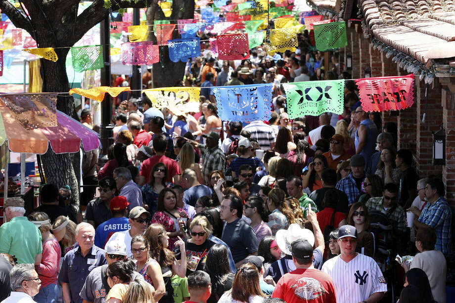 Crowds fill Market Square during the Cinco de Mayo celebration on Sunday. The holiday marks a May 5, 1862, victory by Mexican forces over the French. Photo: Edward A. Ornelas / San Antonio Express-News