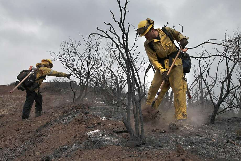 Crews inspect burned areas in Newbury Park, California, Sunday, May 5, 2013. (Michael Robinson Chavez/Los Angeles Times/MCT) Photo: Michael Robinson Chavez, McClatchy-Tribune News Service