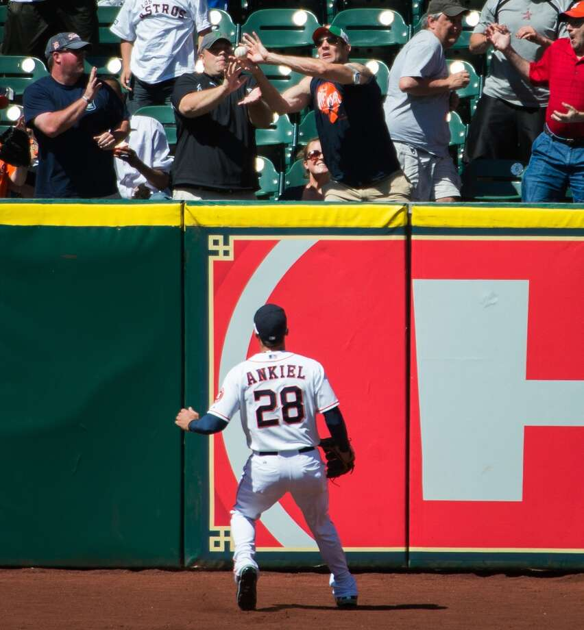 Astros right fielder Rick Ankiel (28) watches as fans try to catch a home run off the bat of Tigers catcher Brayan Pena during the second inning.
