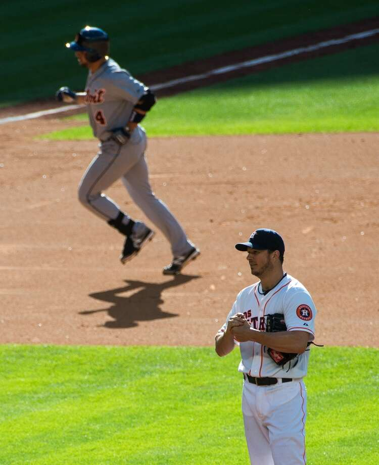 Tigers second baseman Omar Infante rounds the bases after hitting a home run off of Astros pitcher Erik Bedard during the eighth inning.