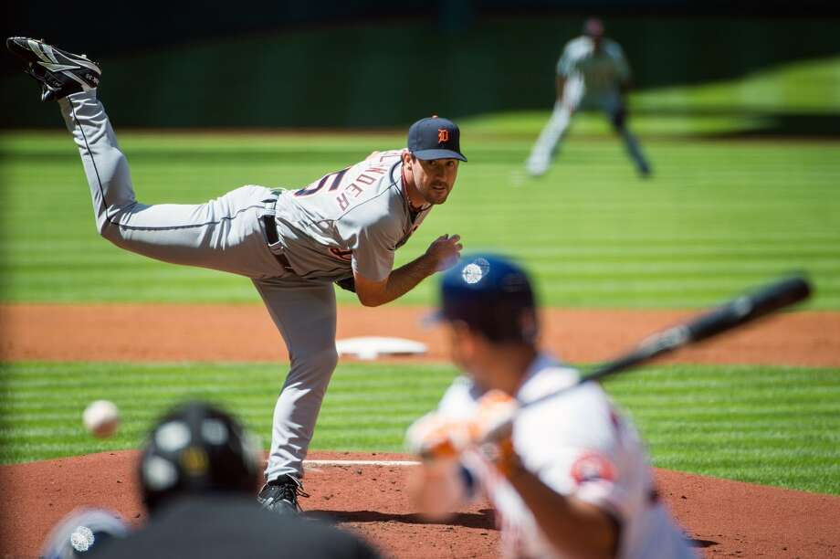 Tigers starting pitcher Justin Verlander pitches to Astros center fielder Robbie Grossman during the first inning.