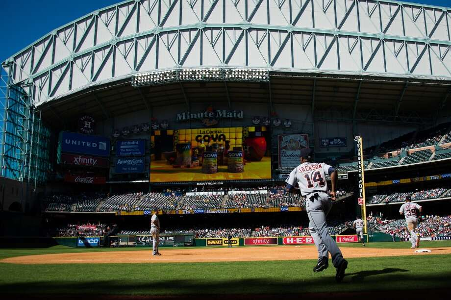 Tigers center fielder Austin Jackson takes the field during the fourth inning. Photo: Smiley N. Pool, Houston Chronicle