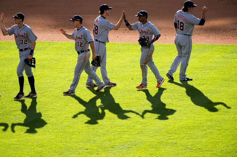 Tigers players celebrate after a 9-0 victory. Photo: Smiley N. Pool, Houston Chronicle