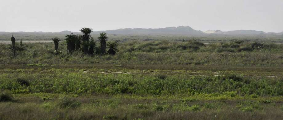 Land near Boca Chica Beach, with sand dunes in the distance, could be used for SpaceX's commercial spaceport. Texas is among several states competing for it.
