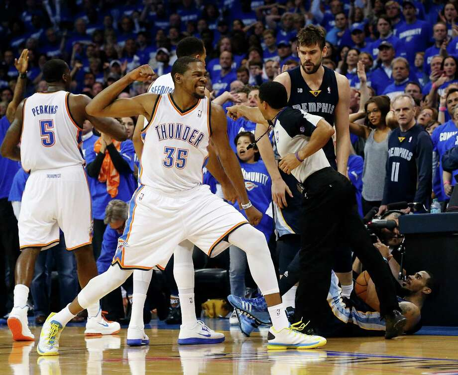 Kevin Durant (35) feels it after Memphis' Mike Conley, bottom right, was called out of bounds and the ball awarded to Oklahoma City in the final minute Sunday. Photo: Sue Ogrocki, STF / AP