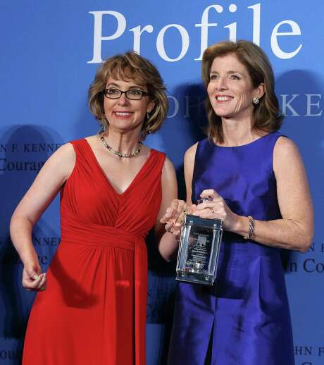 Caroline Kennedy (right) displays the 2013 Profile in Courage award she had just presented to former U.S. Rep. Gabrielle Giffords (left) at the John F. Kennedy Library in Boston. Photo: Associated Press