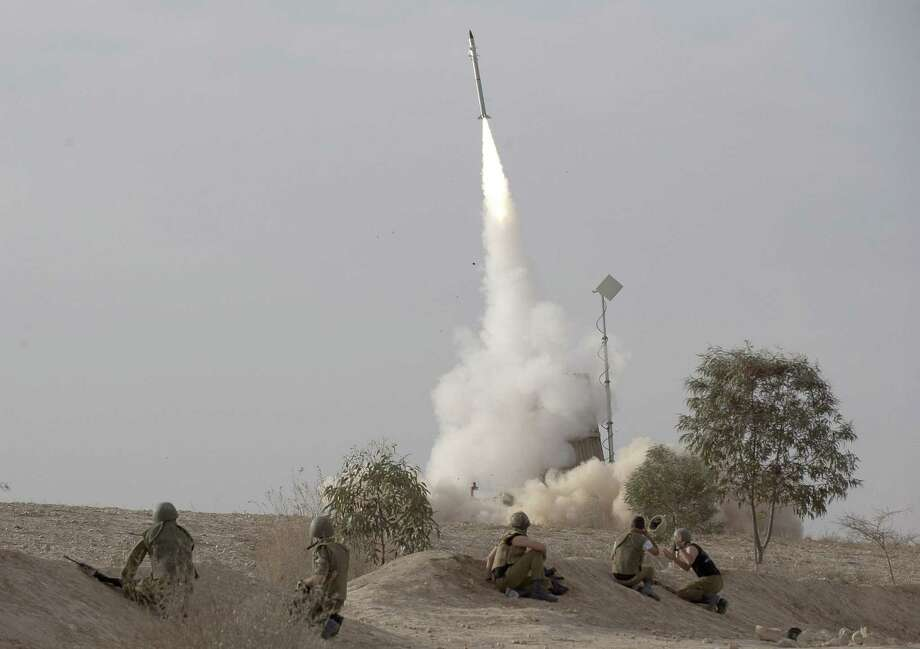 Near its northern border, Israel has deployed two of its Iron Dome rocket defense batteries, one shown here being launched last year. Photo: Associated Press File Photo