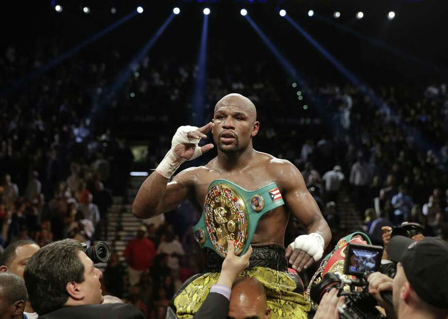 "Floyd Mayweather Jr. enjoys the moment after beating Robert Guerrero by unanimous decision. ""I showed the world I can still box,"" Mayweather said. Photo: Isaac Brekken / Associated Press"