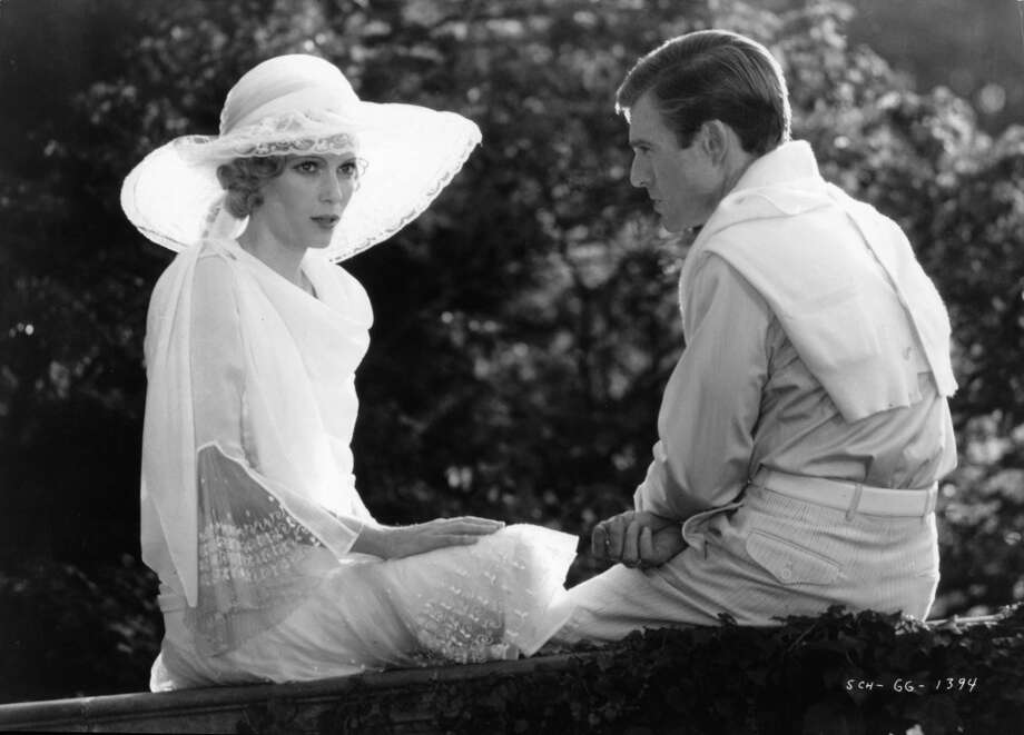 "Mia Farrow and Robert Redford, as Daisy Buchanan and Jay Gatsby, outside together in a scene from the film ""The Great Gatsby,"" 1974."