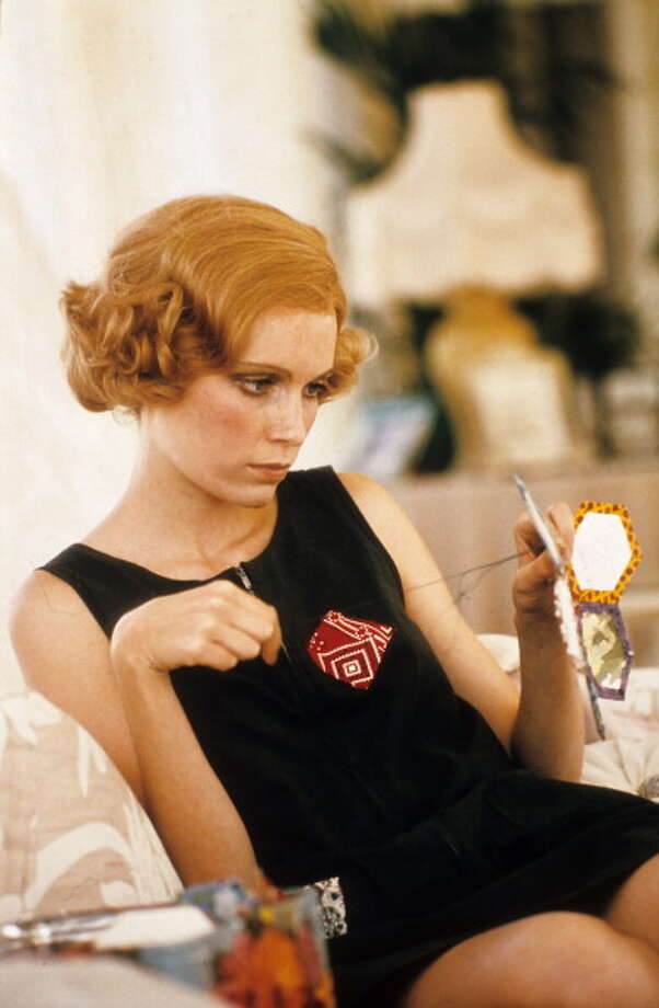 "Mia Farrow as Daisy Buchanan knitting in a scene from the film ""The Great Gatsby,"" 1974. Photo: Michael Ochs Archives, Getty Images / 2012 Getty Images"