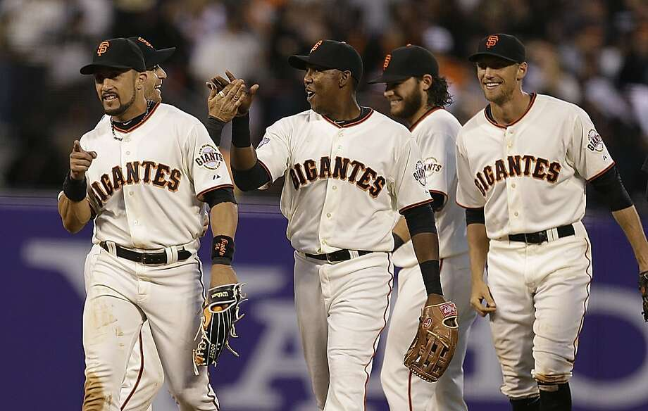 San Francisco Giants' Andres Torres, from left, Francisco Peguero, and Hunter Pence celebrate at the end of a baseball game against the Los Angeles Dodgers, Sunday, May 5, 2013, in San Francisco. The Giants won 4-3. (AP Photo/Ben Margot) Photo: Ben Margot, Associated Press