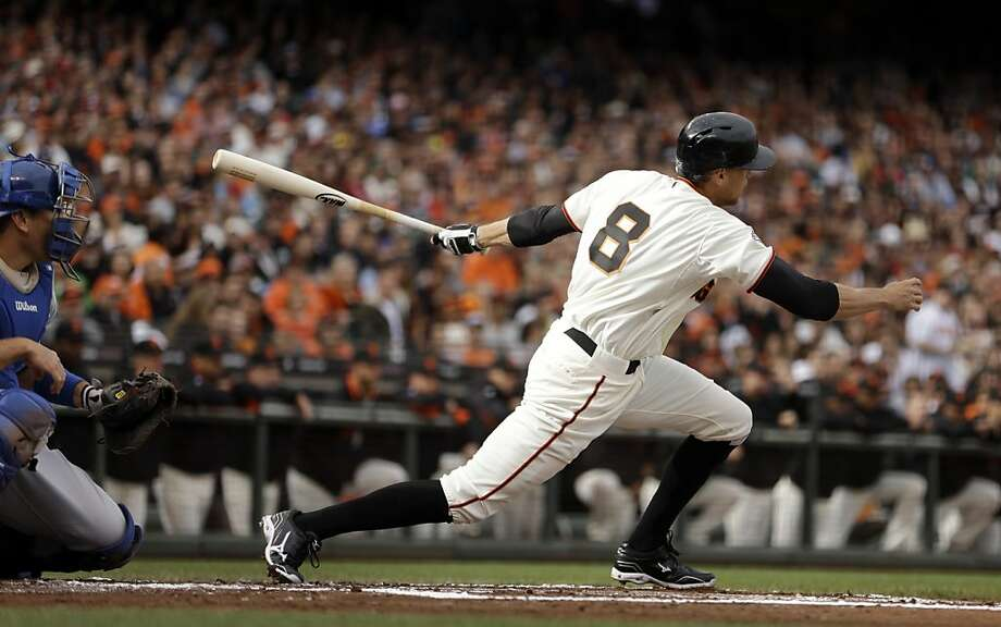San Francisco Giants' Hunter Pence swings for a ground out which led to a run scored on a fielders choice in the first inning of a baseball game against the Los Angeles Dodgers Sunday, May 5, 2013, in San Francisco. (AP Photo/Ben Margot) Photo: Ben Margot, Associated Press