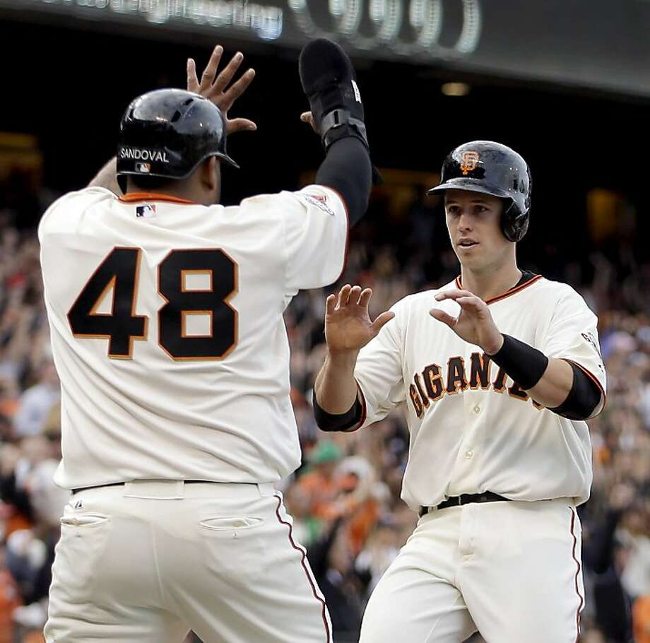 San Francisco Giants' Pablo Sandoval (48) and Buster Posey, right, celebrate as they score against the Los Angeles Dodgers in the fifth inning of a baseball game, Sunday, May 5, 2013, in San Francisco. Both scored on a double by Randy Pence. (AP Photo/Ben Margot) Photo: Ben Margot, Associated Press